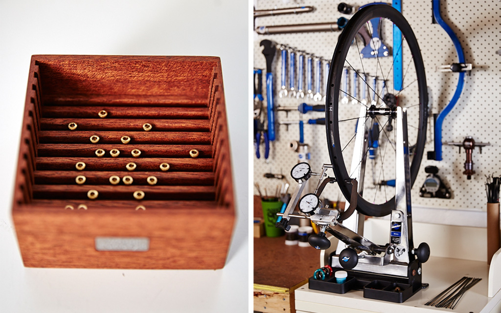 More tools of the trade: the shuffle box on the left is used to orient the spoke nipples, and on the right, a wheel jig.
